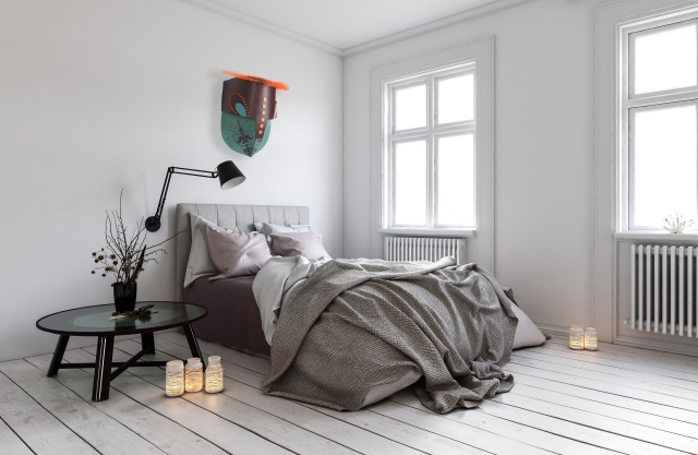 Single bed in room with radiators under windows